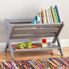 Grey book caddy - it can also be used to store toys, games, knickknacks and more.