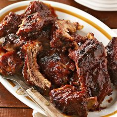 Fall tailgating just got easier. These saucy, spicy-sweet ribs cook low and slow on your countertop, then brown to caramelized goodness after a quick broil. Pack 'em before the big game, and don't expect to bring home leftovers!