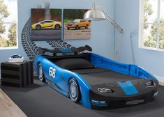 Sweet dreams are just around the corner with the Turbo Race Car Twin Bed from Delta Children! Designed to resemble a classic race car, fun details include a rear spoiler, a front grill and racing tire Twin Car Bed, Toddler Car Bed, Kids Car Bed, Race Car Room, Race Car Bed, Car Themed Rooms, Car Bedroom, Hot Wheels Bedroom, Kids Bedroom Designs