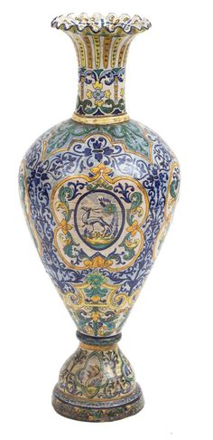An Italian Majolica Urn Height 38 1/2 inches, early 19th century.