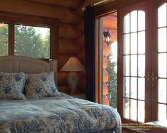 A small bedroom in a handcrafted log home  #loghomes #loghomedesign #ontario #logconstruction  For more photos of this or more of my designs, please check out my website, www.designma.com, my Design Page, www.facebook.com/loghomedesign