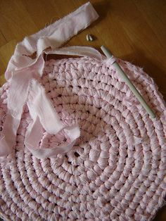 Crochet Rag Rug...When I was a little girl, my mother used to make rugs like these out of my old sheets!! I would go to school with CareBear sheets on my bed then come home and my sheets turned into a cute little rug!! Momma, I miss you everyday and I hope you are looking down from heaven!!