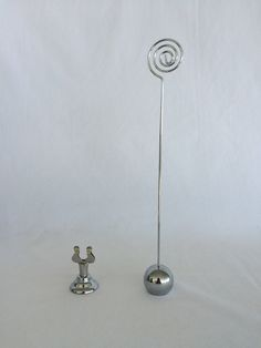 Small Silver Table Stands - over 20 available .75 each.  Tall stands SOLD