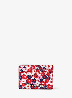 c993347794 Our chic and compact Jet Set card case is sleek enough to slip into any  tote