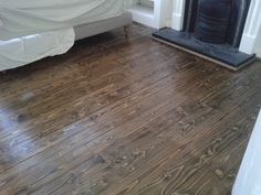 Pine floorboards sanded, stained dark JacobeanOak and polished. http://www.mybuilder.com/profile/view/elf1floors