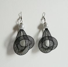 Black plastic mesh tubes earrings with pearls inside. by Vittro, $20.00