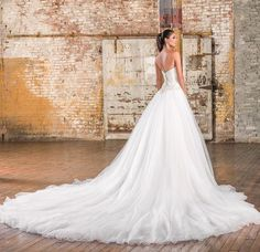 Elegant embellished strapless ballgown wedding dress; Featured Dress: Justin Alexander