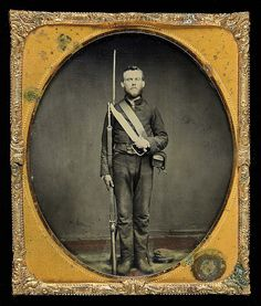 "The fine sixth plate ambrotype on ruby glass (2.75"" x 3.25"") shows a young, bearded private posed in full view with his blockade run English gear including Enfield rifled-musket with bayonet, snake buckle belt & Enfield cartridge box. The soldier also proudly brandishes his large D-Guard Bowie Knife no doubt made by local craftsmen possibly in Georgia near Savannah."