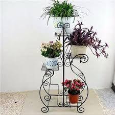 adornos de hierro forjado para pared - Buscar con Google Planter Pots, Iron, Patio, Metal, Flowers, Google, Gardens, Appliques, Ornaments