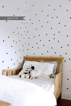 dots on the wall, to pull in the black polka dot chair