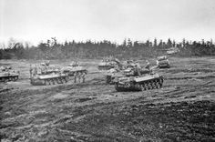 US Hellcat & Sherman Tanks with an abandoned King Tiger