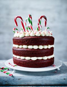 The perfect Christmas showstopper cake! Three layers of red velvet sandwiched with a creamy peppermint icing and topped with colourful candy canes.