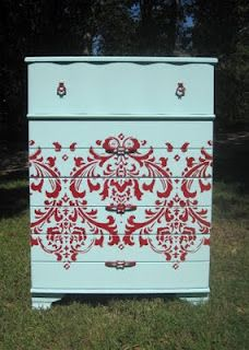 light blue painted dresser with red damask stencil
