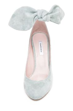 The bow is too big, but very pretty shoe...the bow reminds me of a pale blue suede Bandolino back in the 70's...
