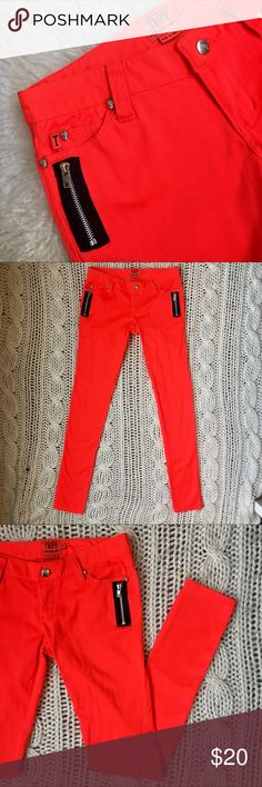 "Tripp NYC Biker Skinny Jeans tripp nyc daang goodman low-rise bright orange / red skinny jeans with contrasting black zippers • size 3, fits like a 26 • no flaws, in perfect pre-owned condition • 32"" inseam • 7"" rise • 53% cotton, 44% polyester, 3% spandex Tripp nyc Jeans Skinny"