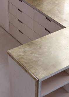 Brushed Brass benchtop. Merrydown House in Dorset, UK by McLaren Excell | Yellowtrace