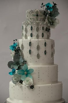 This was the first Asian wedding cake at Happyhills Cakes, was really fab to be able to go to town with glamorous beads and beautiful colours, all in keeping with the bride???s fully beaded dress and turquoise wrap. It was fascinating to see the...