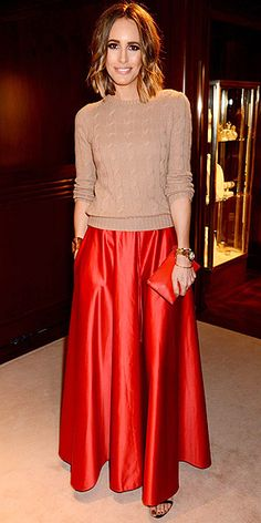 Louise Roe in a tan cable knit sweater and orange silk maxi skirt with coordinating clutch at the London launch of her book Front Roe. #Fashion