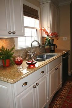 Small kitchen remodel - white cabinets and beige granite counters. I would love to do this