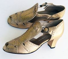 A 1920's/1930's style with a unique wide T-strap and intricate perforated details. Leather uppers and leather soles Whole and half sizes, 5 ½-11 (Runs long - or