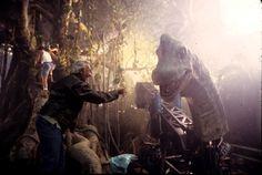 Special effects technician Stan Winston looks over an animatronic Brachiosaurus on the set of Jurassic Park.