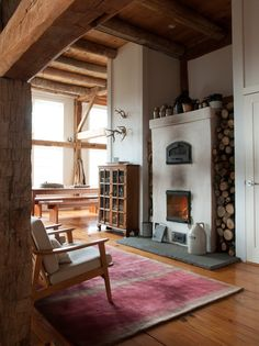 """""""The fireplace is based on a Finnish design and acts as a furnace to heat the entire main floor,"""" Bill says. ♥ Loved and pinned by www.ductworks.ca"""