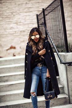 fashion blogger mia mia mine wearing a black double-breasted coat from macy's