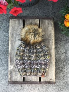 Hand knit bulky beanie with a fabulous faux fur pom