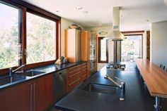 Love the giant windows right down to the counter. Also like the flat panel cabinets.                                              kitchen contemporary kitchen