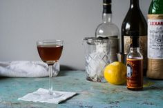 Recipe for the Martinez cocktail, a pre-Prohibition drink with Old Tom gin, sweet vermouth, and maraschino liqueur. Alcoholic Drinks, Cocktails, Gin, Bubbles, Glass, Craft Cocktails, Drinkware, Corning Glass, Cocktail