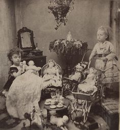 Two Little Girls with Dolls and Toys - c. 1870s by Photo_History