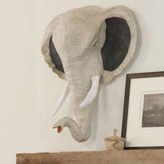 "All Ears Elephant  :: And all heart, too. Hand-sculpted from papier-mache in Haiti by displaced earthquake survivors, our majestic pachyderm arrives ready to wall mount and is sure to brighten up any room with her regal aplomb.   24""W x 27""H x 9.5""D"