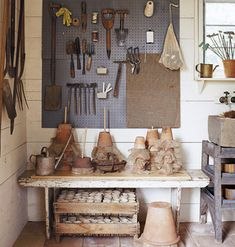 painted pegboard, bench, rustic wood,organized gardening/potting tools