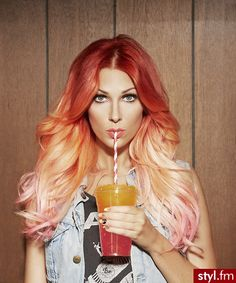 A unique spin on Ombre hair using varying shades of red instead of brown helps to spice up the most current trend.