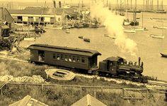 Nantucket Railroad at harbor. Little 2-4-4 pulling a combo baggage/passenger car.