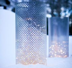 Pretty luminaries made of decorative aluminum sheets, floral wire, and (of course) mini lights. I like this idea so much!