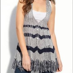 Free People crochet vest Free People crochet fringe vest. Amazing layering piece in the gray and may combo with white and metal buttons. Size small. Sold out everywhere! Free People Jackets & Coats Vests
