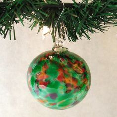Green and Cranberry Blown Glass Ornament by Fireworks Glass Studio