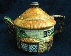 A ceramic cottage tea pot. Marked Beswick Ware; made in England.http://caljackscollectibles.ecrater.com/p/10273055/vintage-beswick-ware-cottage-teapot - photo at Online Sellers