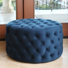 Freshen up your home decor with the Ella blue tufted round velvet ottoman. Designed by Abbyson Living, this engaging furniture will brighten any space.
