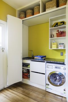 Lou's laundry carries on the yellow theme, in Resene Hive. Project by Lou Barker. Yellow Theme, Bespoke Furniture, Colorful Furniture, Stacked Washer Dryer, Colour Schemes, Soft Furnishings, Scarlet, Cupboard, Custom Design