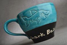 Shark Bait Mug: Caribbean Blue Black Shark Bait Soup Cocoa Coffee Mug by Symmetrical Pottery Made To Order. $20.00, via Etsy.