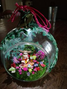 Inside the glass ball i have made a miniature artificial garden and put mini led lamp there too