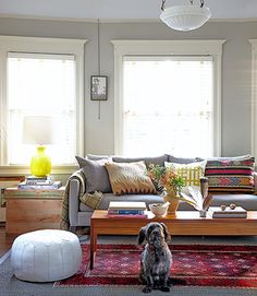 The owner of this vintage California cottage nabbed this wool HD Buttercup sofa for half the price, and searched for the midcentury teak table on Craigslist.   - CountryLiving.com