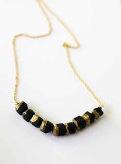 gold dipped large geo beaded necklace in black