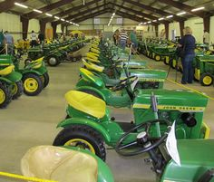 """A SEA OF GREEN: An entire building at the Dodge County Fairgrounds in Wisconsin was filled with more than 100 original 1963 John Deere 110 Lawn and Garden Tractors, and four prototypes, during the """"Weekend of Freedom Machines"""" event last weekend. That represented more than 10 percent of the original product run!— with Clayton Pierce, Taylor Payne, Lon Townsend and Cindy Vail"""