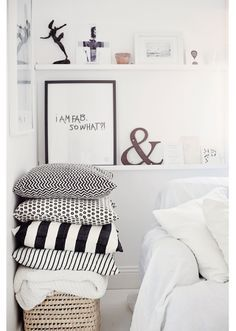 Different prints of black and white for the dining chair pillows.