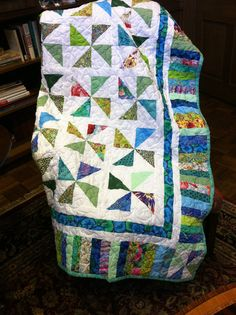 A beautiful homemade queen size quilt made in my home sewing studio. I use my own pattern for this simple quilt design. I used lots of various