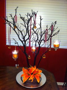 Ordered two manzanita trees in dark brown with champagne satin bases. I will hang placecards to tell people what table they are at on the branches--one for family, one for friends