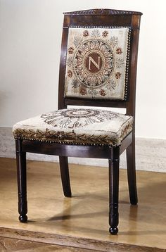 Chair (one of a pair), early 19th century. Tapestry upholstery: Beauvais. French. The Metropolitan Museum of Art, New York. Gift of Mrs. S.E. Minton, 1899 (02.15) | This chair belonged to French Emperor Napoleon Bonaparte, who modeled himself after ancient Roman emperors. The tapestry-covered cushions are emblazoned with his initial and one of his favorite regal Roman symbols: laurel leaves. #tapestrytuesday